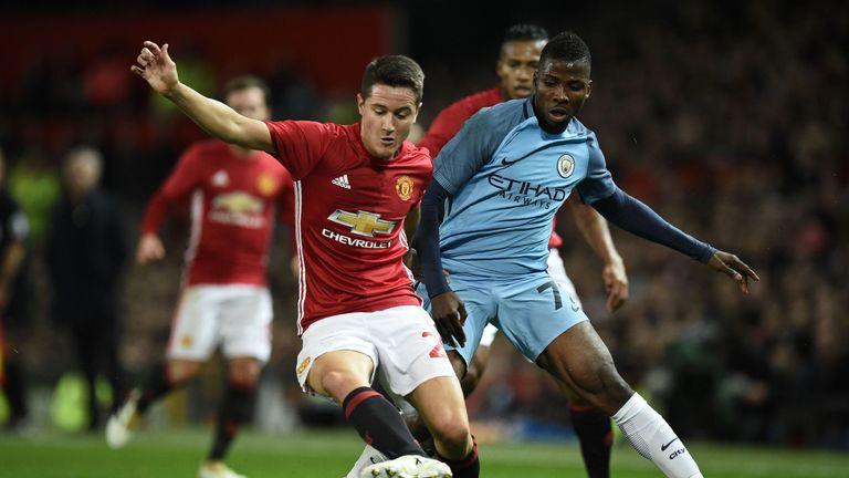 Manchester United midfielder Ander Herrera (L) vies with Manchester City striker Kelechi Iheanacho