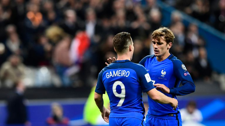 France's forward Antoine Griezmann (R) celebrates with France's forward Kevin Gameiro after scoring during the FIFA World Cup 2018 qualifying football matc