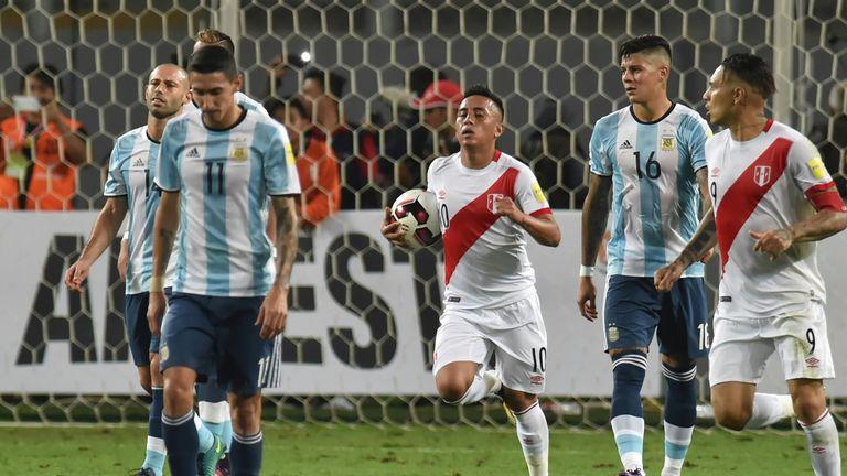 Christian Cueva (centre) celebrates scoring Peru's second equaliser against Argentina