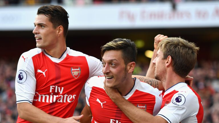 LONDON, ENGLAND - OCTOBER 15: Mesut Ozil of Arsenal (C) celebrates scoring his sides third goal with his Arsenal team mates during the Premier League match