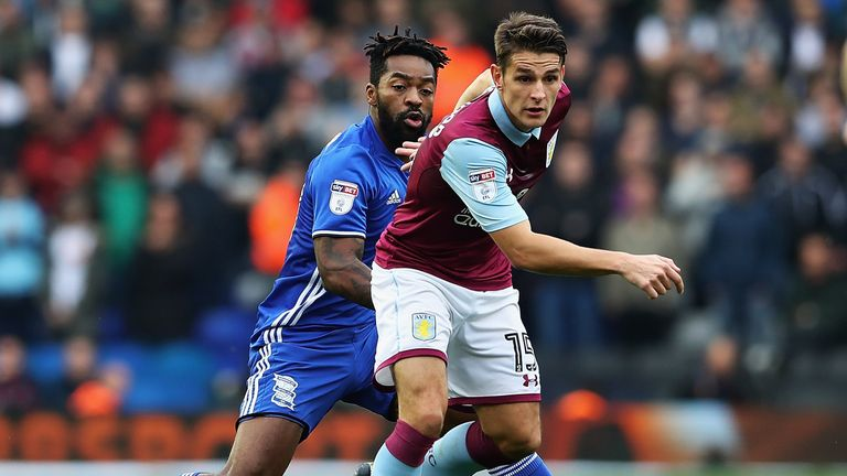 Ashley Westwood of Aston Villa wins the ball from Jacques Maghoma of Birmingham City