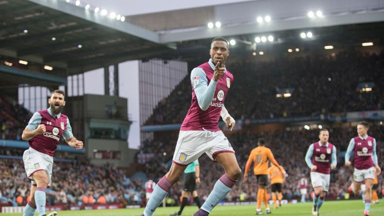 Jonathan Kodjia of Aston Villa celebrates after scoring the opening goal
