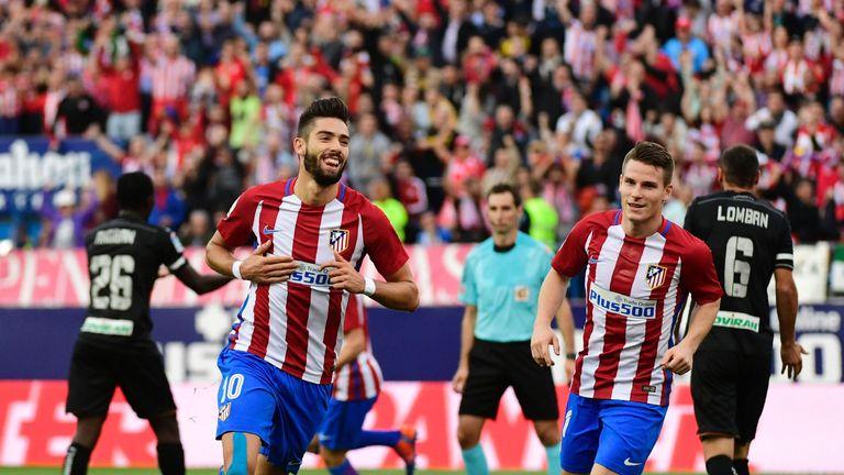 Atletico Madrid's Belgian midfielder Yannick Ferreira Carrasco (L) celebrates after scoring during the Spanish league football match Club Atletico de Madri