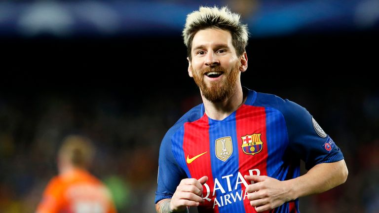 Lionel Messi celebrates after scoring his second goal against Manchester City