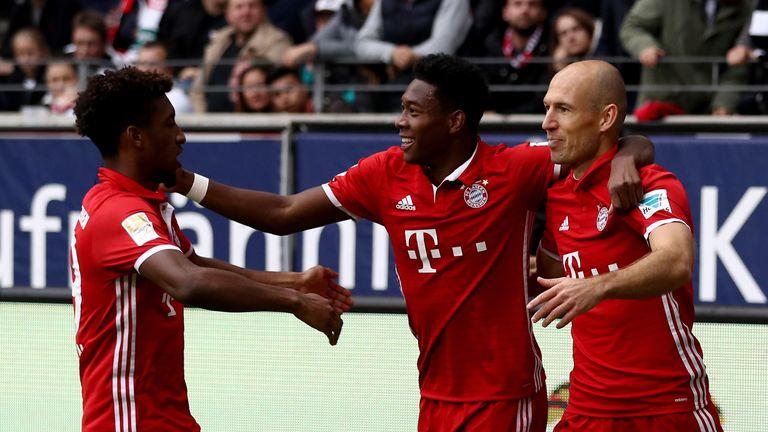 Bayern Munich players celebrate after Arjen Robben's opening goal against Frankfurt
