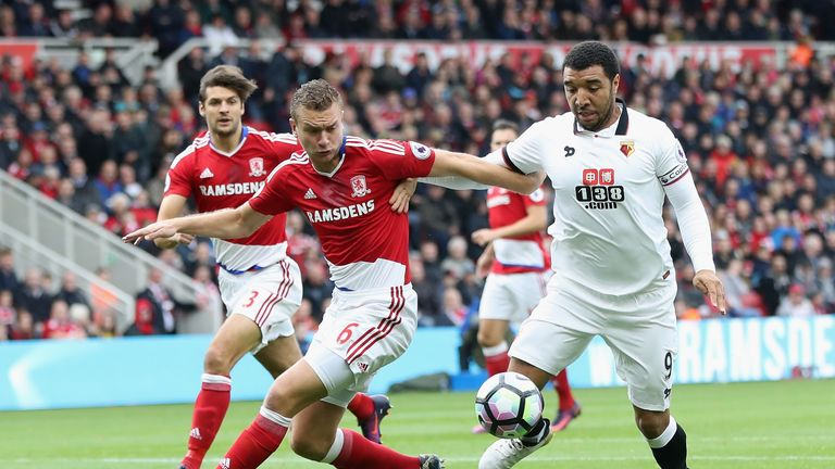 Ben Gibson of Middlesbrough and Troy Deeney of Watford battle for possession during the Premier League clash