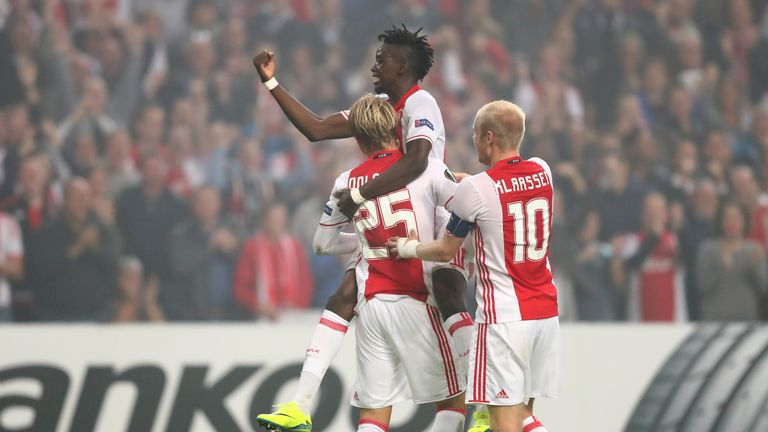 Dolberg is congratulated by teammates Bertrand Traore and Davy Klaassen