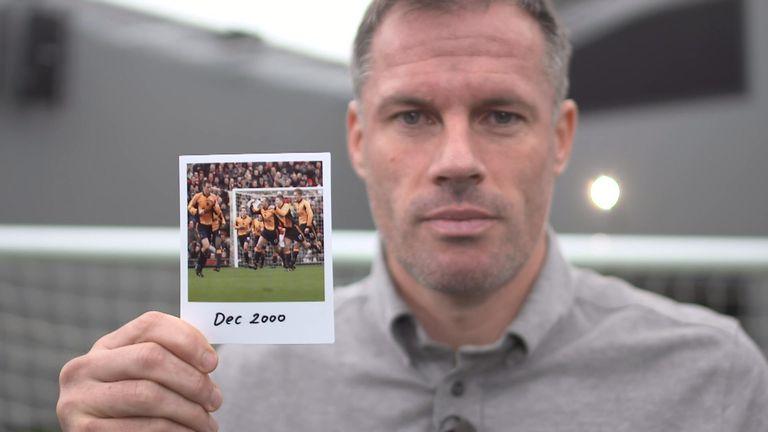 Jamie Carragher holds December 2000 photo