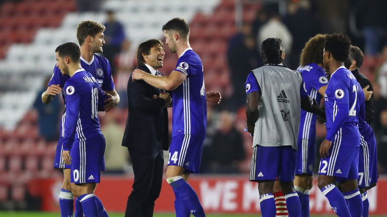 Antonio Conte, Manager of Chelsea (C) and Gary Cahill of Chelsea (CR) embrace after the final whistle during the Premier League match against Southampton