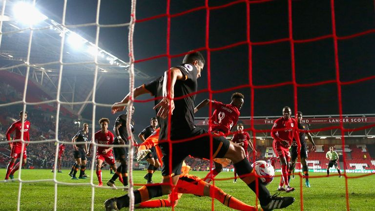 Curtis Davies (C) clears the ball off the line from a Tammy Abraham shot