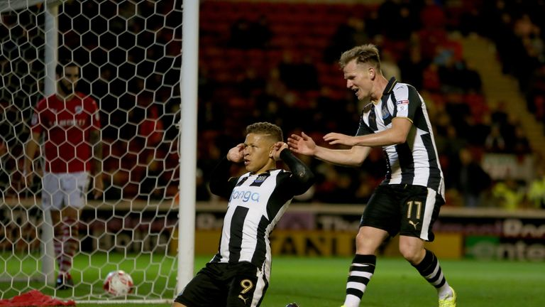Newcastle United's Dwight Gayle celebrates his 2nd goal with Matt Ritchie during the Sky Bet Championship match at Oakwell, Barnsley.