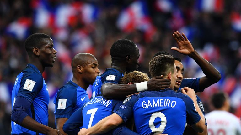 France's forward Kevin Gameiro (Front R) is congratuled by teammates Dimitri Payet (R), Antoine Griezmann (C) and Moussa Sissoko (Rear C), Paul Pogba (L) a