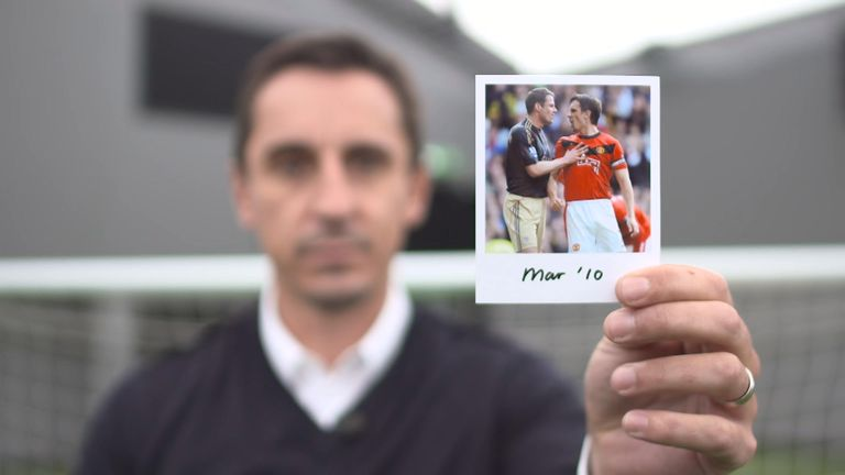 Gary Neville holds March 2010 photo