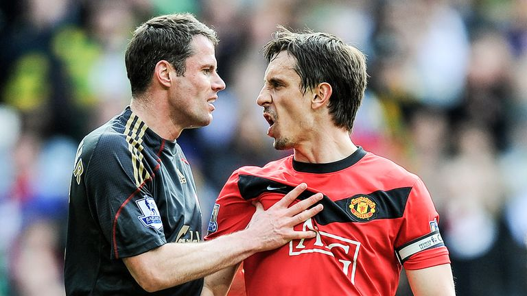 Jamie Carragher and Gary Neville exchange words after Manchester United are awarded a penalty