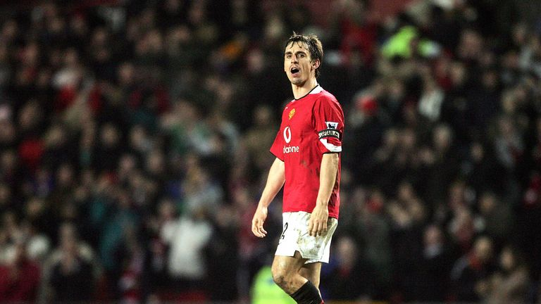 Gary Neville looks to the Liverpool fans after Manchester United win at Old Trafford in January 2006