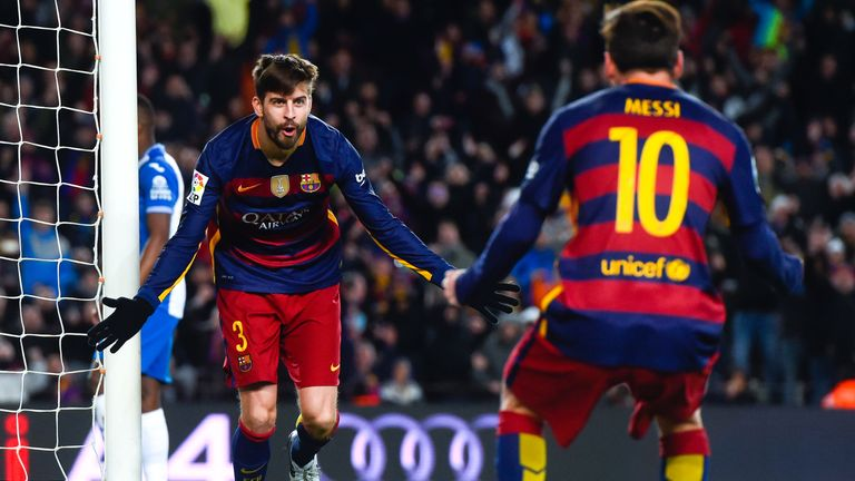 BARCELONA, SPAIN - JANUARY 06:  Gerard Pique of FC Barcelona celebrates with his teammate Lionel Messi of FC Barcelona after scoring his team's third goal