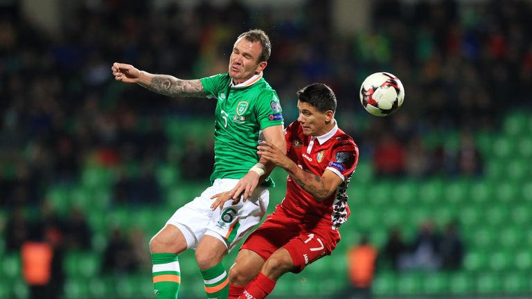 Republic of Ireland's Glenn Whelan (left) and Moldova's Gheorghe Andronic battle for the ball during 2018 FIFA World Cup Qualifying, Group D at the Zimbru