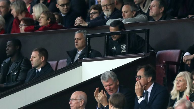 Mourinho (centre top) watches from the crowd having been sent to the stands by referee Mark Clattenburg