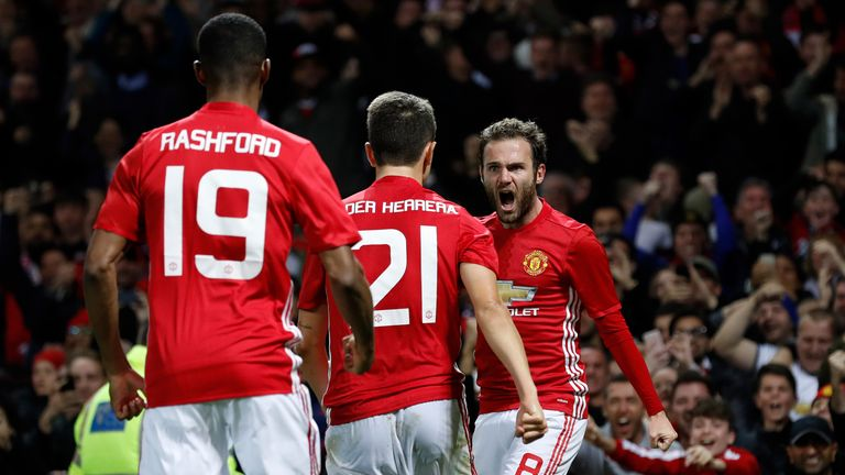 Manchester United's Juan Mata (right) celebrates after scoring his side's first goal