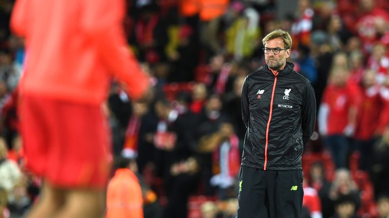 Jurgen Klopp watches his players warm up ahead of the match at Anfield