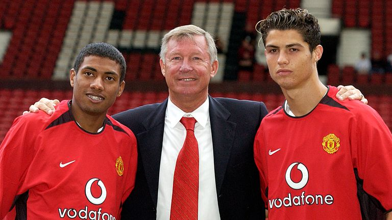Sir Alex Ferguson poses with Kleberson and Cristiano Ronaldo for photographers on the pitch..Kleberson and Cristiano Ronaldo Sign For Man Utd, Old Trafford