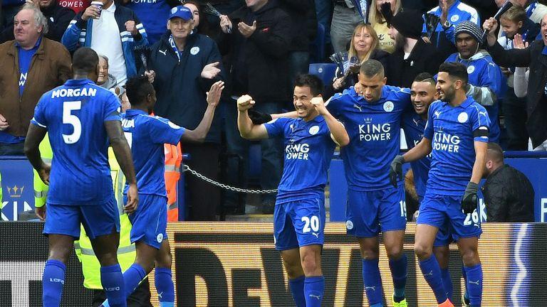 Shinji Okazaki of Leicester enjoys his moment with his team-mates