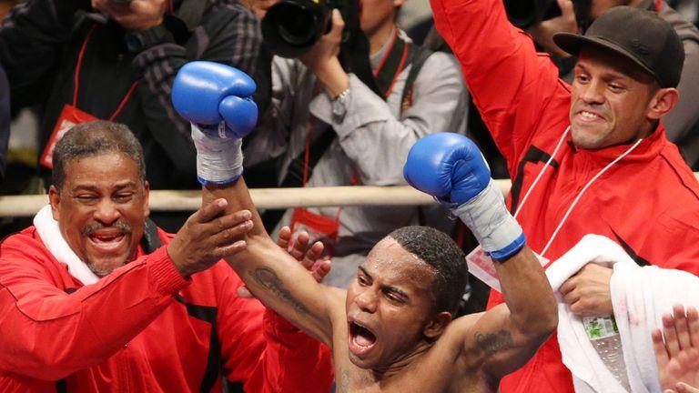 Liborio Solis of Venezuela celebrates after beating Daiki Kameda of Japan during their IBF Super Flyweight /WBA World Super Fly title
