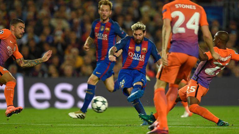 Lionel Messi (C) scores his second goal against Man City