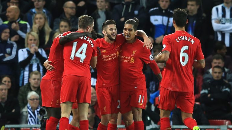 LIVERPOOL, ENGLAND - OCTOBER 22: Philippe Coutinho of Liverpool (Not pictured) celebrates scoring his sides second goal with his team mates during the Prem