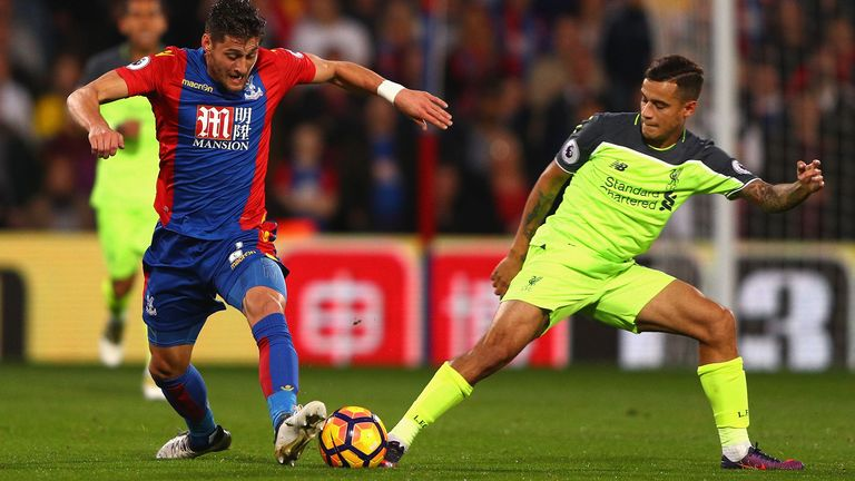 Philippe Coutinho competes with Joel Ward during the match