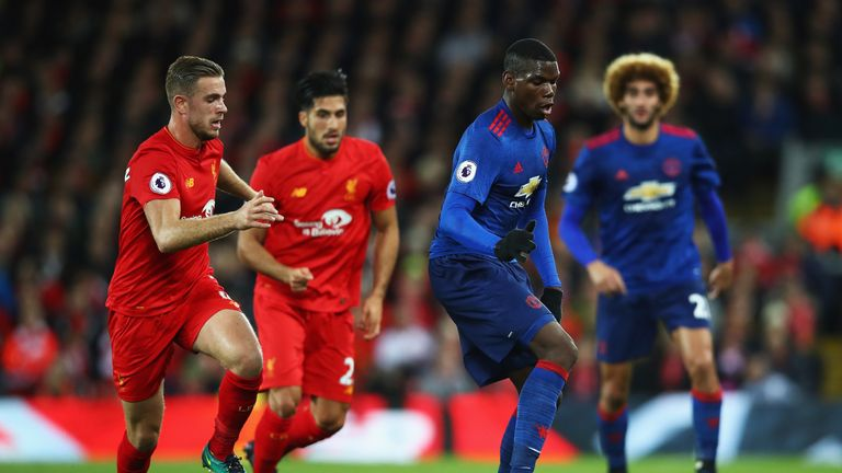 LIVERPOOL, ENGLAND - OCTOBER 17:  Paul Pogba of Manchester United is closed down by Jordan Henderson of Liverpool during the Premier League match between L