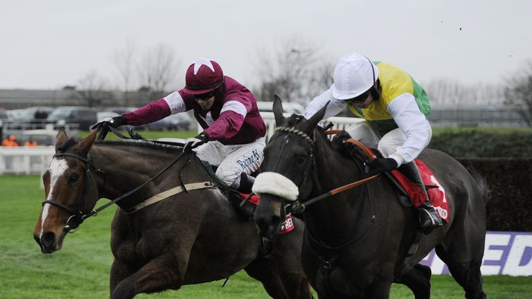 Don Polli ridden by Bryan Cooper (left) beats Many Clouds ridden by Leighton Aspell to win the Betfred Lotto £100k Cash Giveaway Chase during the Betfred