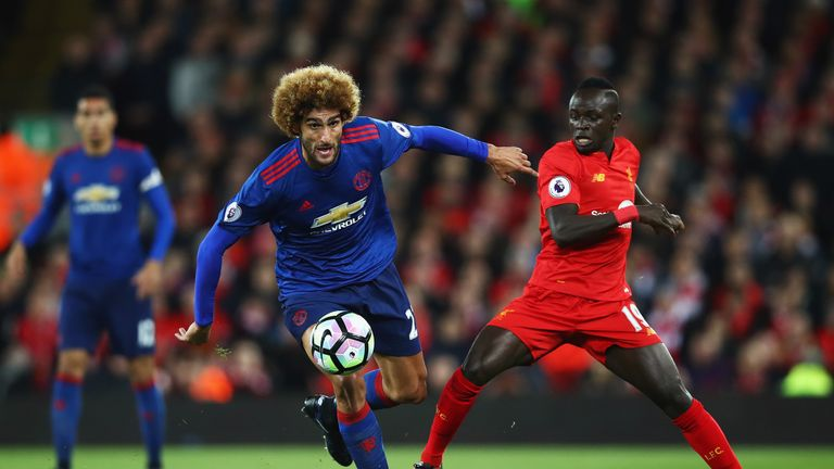 LIVERPOOL, ENGLAND - OCTOBER 17:  Sadio Mane of Liverpool challenges Marouane Fellaini of Manchester United during the Premier League match between Liverpo