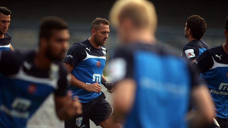 Le footballeur Michael Chopra (C) des Kerala Blasters FC s'entraîne avec ses coéquipiers à la veille de leur match de football de la Super League indienne (ISL) contre l'Atlético De Kol