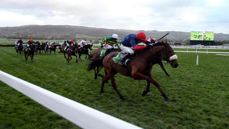 Old Guard ridden by Harry Cobden (red cap) on their way to victory in the StanJames.com Greatwood Hurdle at Cheltenham