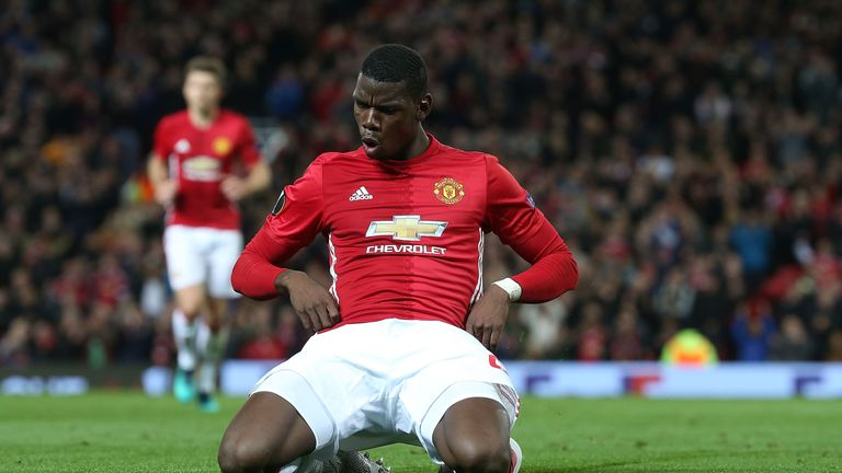 Paul Pogba celebrates after putting Man Utd three goals ahead