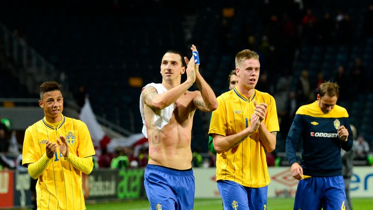 Sweden's midfielder Tobias Sana (L), striker and team captain Zlatan Ibrahimovic (2nd-L) and defender Pontus Jansson react at the end of the FIFA World Cup