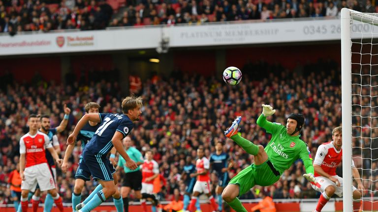 LONDON, ENGLAND - OCTOBER 22:  Petr Cech of Arsenal (R) saves Gaston Ramirez of Middlesbrough (L) header  during the Premier League match between Arsenal a