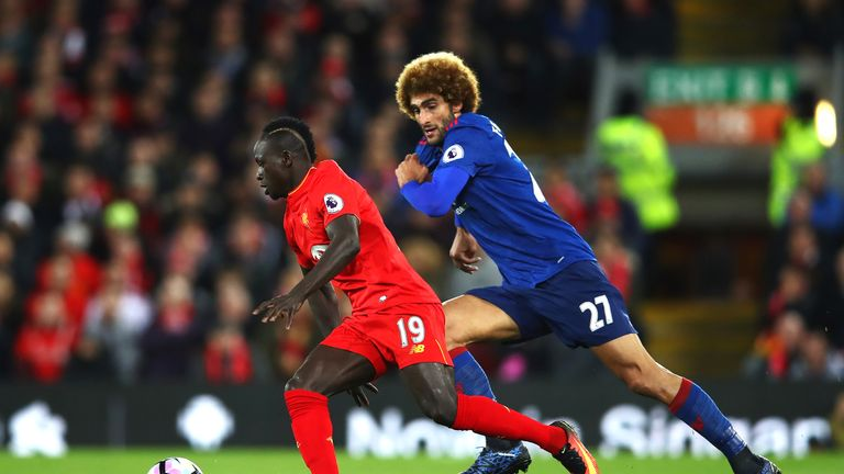 Sadio Mane takes on Marouane Fellaini in the first half at Anfield