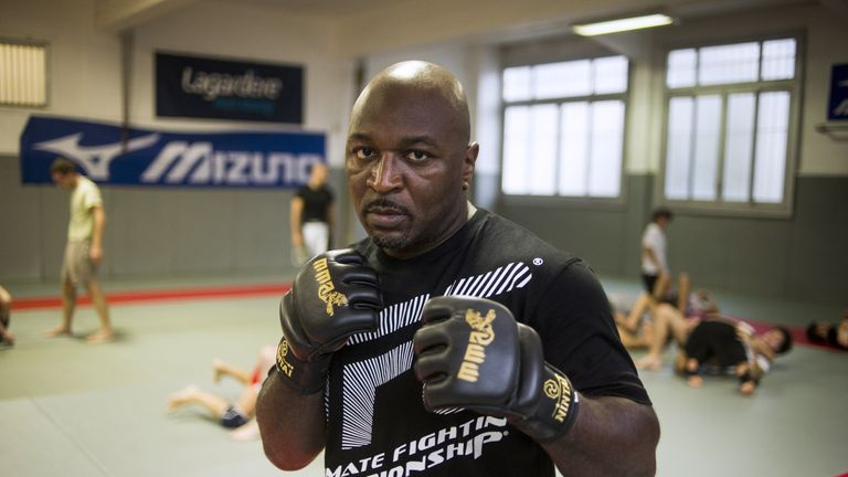 Bertrand Amoussou, president of french mixed martial arts (MMA) commission, poses on October 3, 2013. AFP PHOTO / FRED DUFOUR        (Photo credit should r
