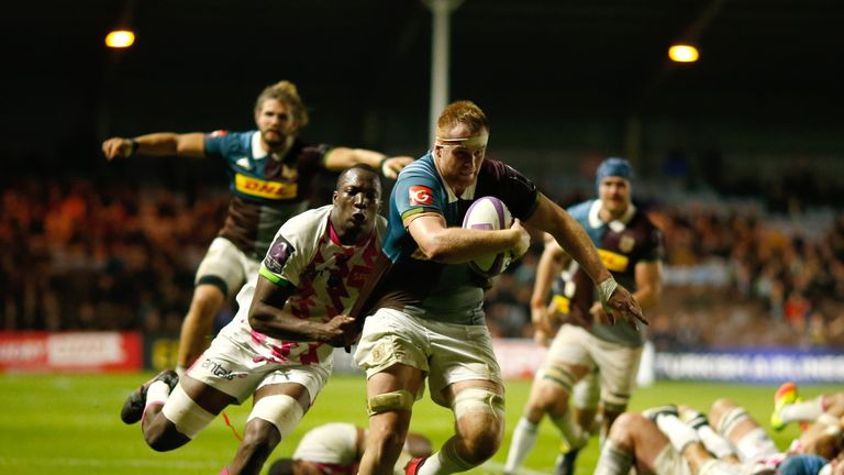 James Chisholm breaks through to score Harlequins' fifth try against Stade Francais