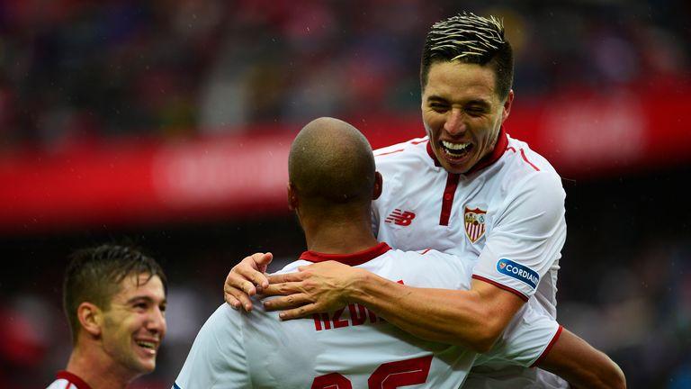 Sevilla midfielder Steven N'Zonzi (back) celebrates a goal with Samir Nasri