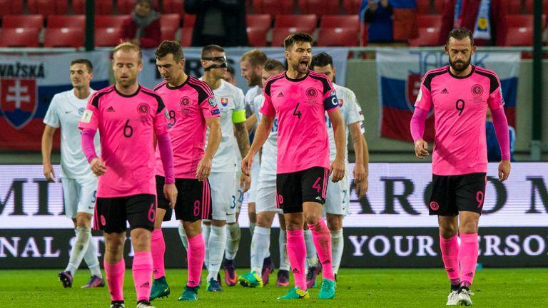 Scotland stand dejected as Slovakia's Adam Nemec scores his side's third
