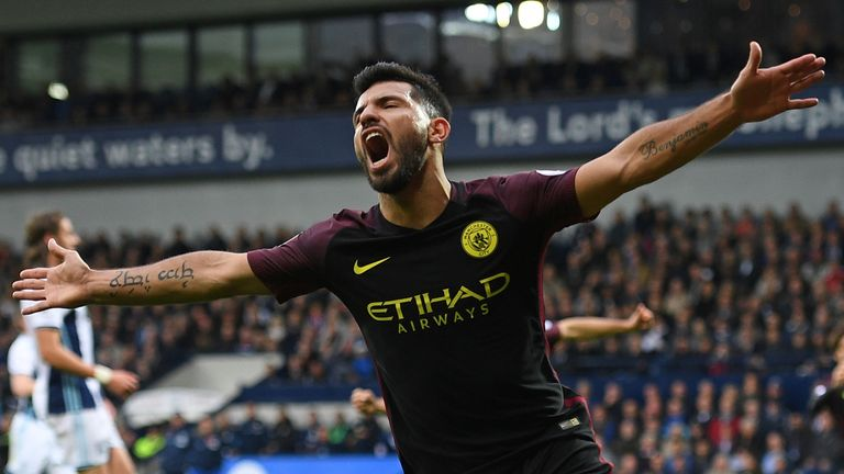 Manchester City's striker Sergio Aguero celebrates after scoring the opening goal