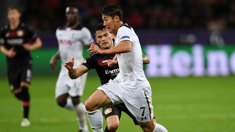 Leverkusen's Charles Aranguiz makes a challenge on Son Heung-Min of Tottenham
