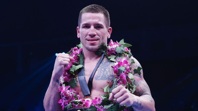 Jason Sosa of the United States celebrates his victory over Javier Fortuna of Dominican Republic