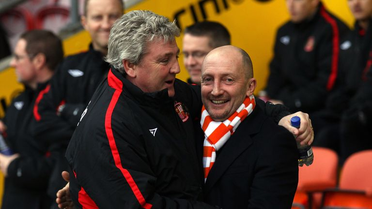 Ian Holloway and Steve Bruce embrace when managing in the Premier League