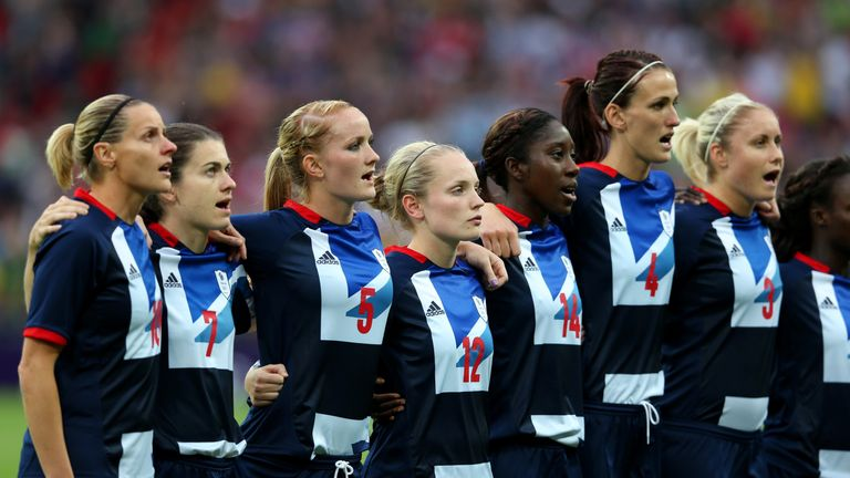 LONDON, ENGLAND - JULY 31:  Team GB players sing the national anthem before the Women's Football first round Group E Match between Great Britain and Brazil