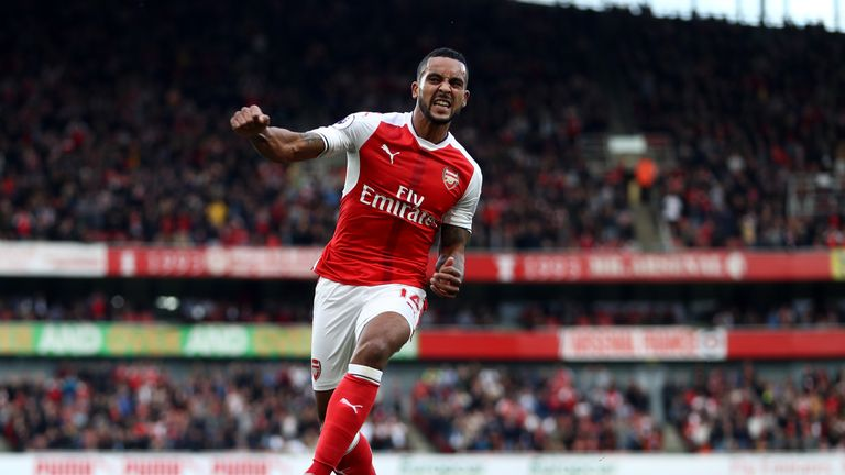 Theo Walcott of Arsenal celebrates after doubling his tally against Swansea