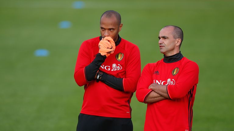 Belgium's assistant coach Thierry Henry (L) talks to Belgium's head coach Roberto Martinez during a training session in Tubize on October 3, 2016, ahead of